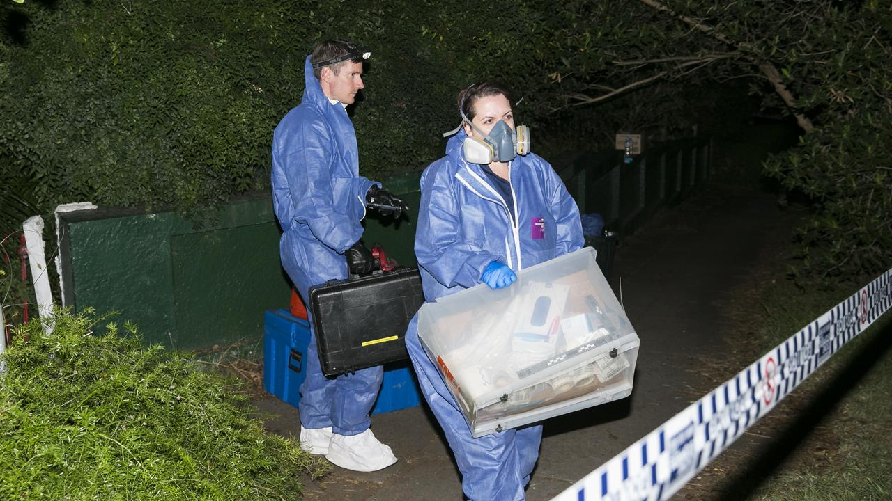 Police and forensics officers remove items after the mummified body of Shane Snellman was found with a shotgun wound to his neck. Picture: Dylan Robinson