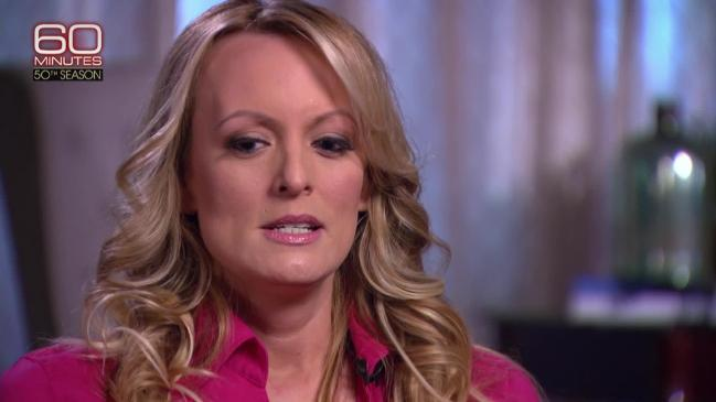 Stormy Daniels says Trump perched on edge of bed before