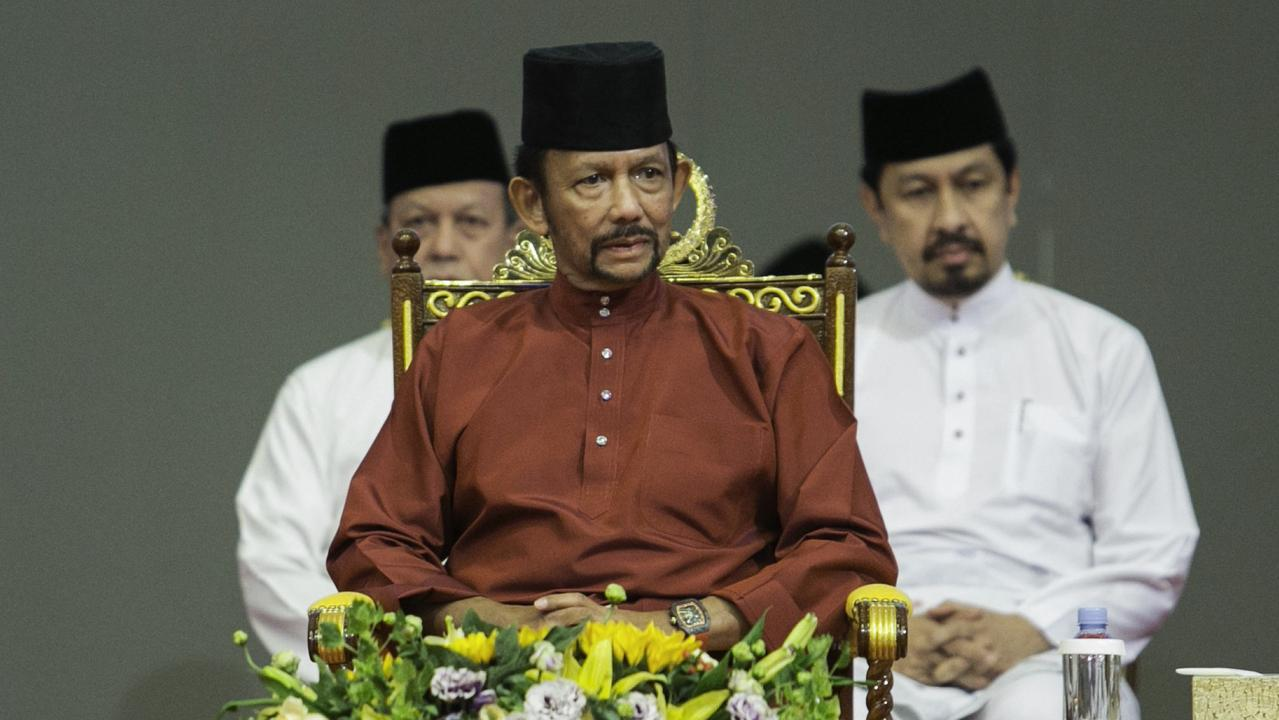 Brunei's Sultan Hassanal Bolkiah has implemented harsh new laws that will make gay sex and adultery punishable by stoning to death. Picture: AFP.