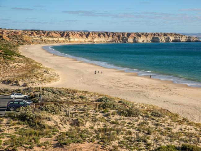"""MASLIN BEACH – ADELAIDE, SOUTH AUSTRALIA Known by the locals as """"Maslins"""", Maslin Beach is considered to be one of the prettiest beaches in South Australia, no doubt due to its pristine shores and impressive sandstone cliffs. If you walk towards the southern end of the 3km stretch of beach and notice a few folks with their kit off, that's quite common – Maslin Beach also is considered a nudist beach. The famous Pilwarren Maslin Beach Nude Games are held here annually."""