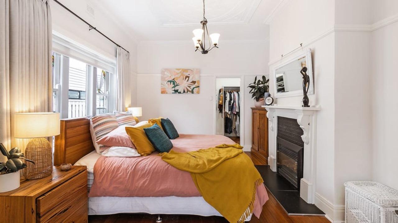 The main bedroom has an original decorative ceiling.