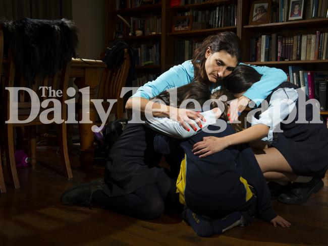Jacqui Blackburn hugs her children who were terrorised on their school bus. Men described as 'drunk' shouted 'Heil Hitler' and 'Kill the Jews' before alighting at Bondi Junction. Picture: Chris McKeen