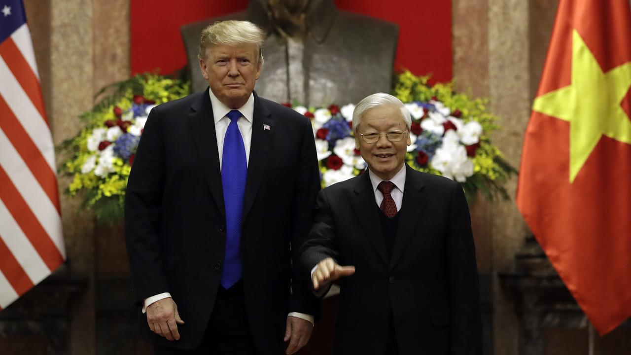 President Donald Trump meets Vietnamese President Nguyen Phu Trong at the Presidential Palace in Hanoi.