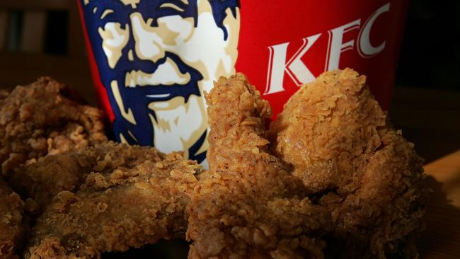 Even the highest-paid executives at KFC must do their time in the kitchen. Picture: Justin Sullivan