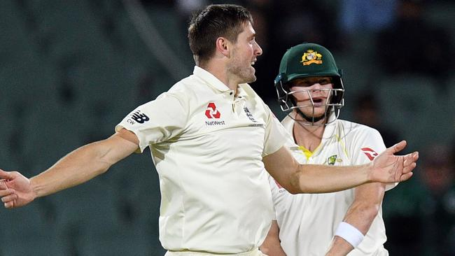 A jubilant Chris Woakes celebrates the prized wicket of Australian captain Steve Smith. Picture: AFP