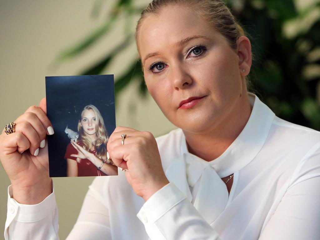 Virginia Roberts holds a photo of herself at age 16, when she says Jeffrey Epstein began abusing her sexually. Picture: Emily Michot/Miami Herald/TNS via Getty