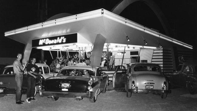 Customers park outside one of the first McDonald's outlets in Des Plaines Illinois in 1955.
