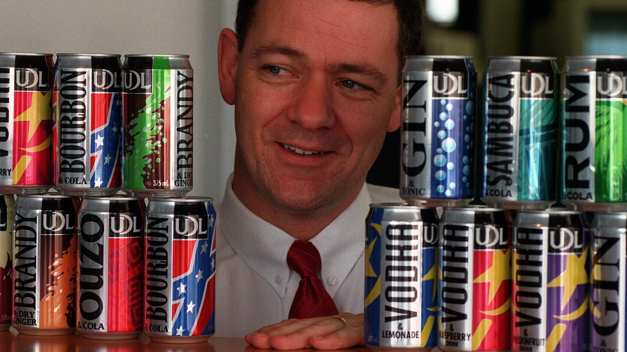Here's another flashback photo when the cans had undergone makeover in 1996 with the then UDL marketing director Kim Manley showing off the new style. Picture: Supplied