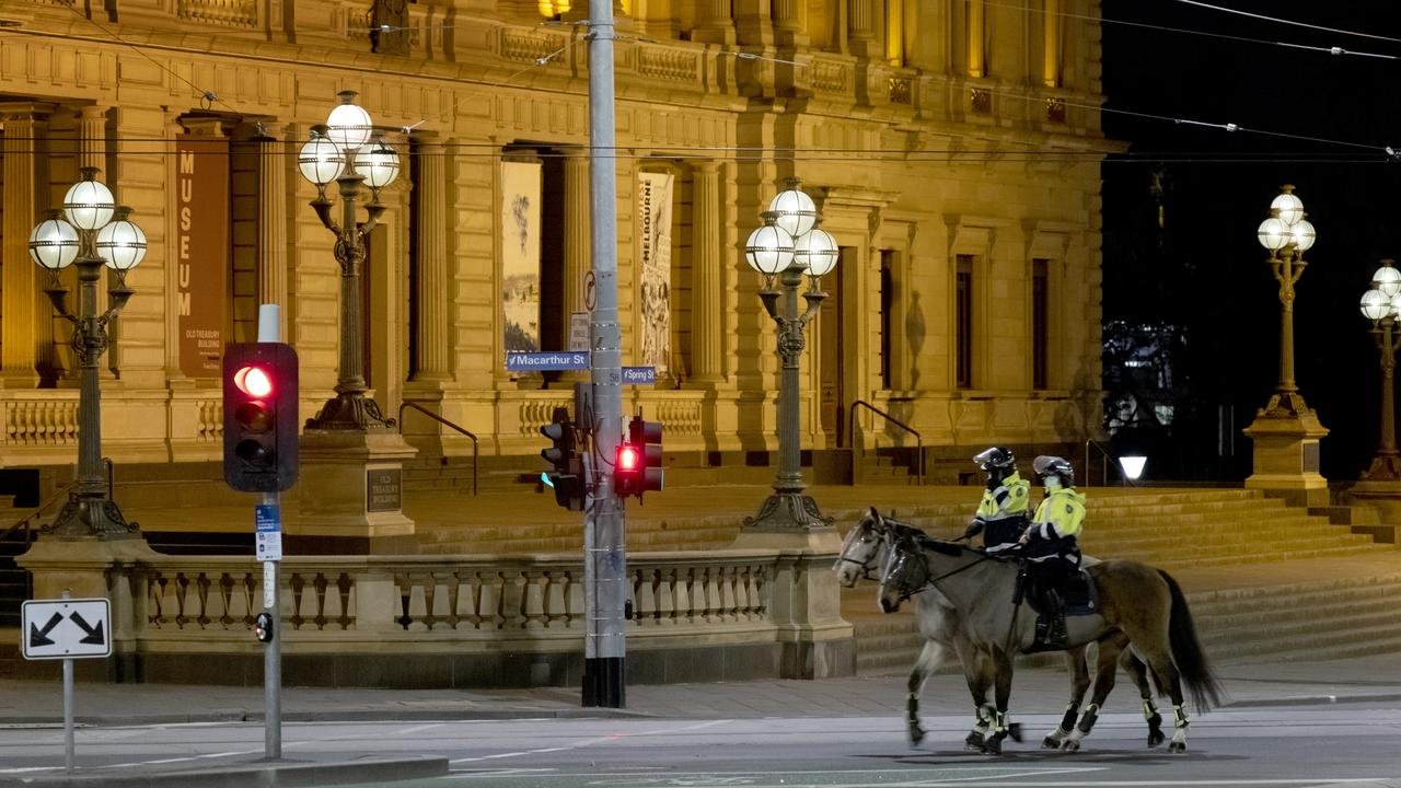 Police officers outside Parliament House on Monday night. Picture: David Geraghty