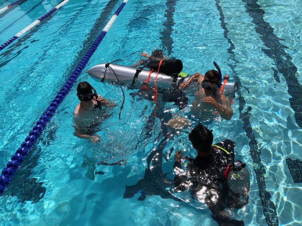 Divers test the device Elon Musk took to Thailand in a pool in Los Angeles. Picture: Elon Musk/ Supplied