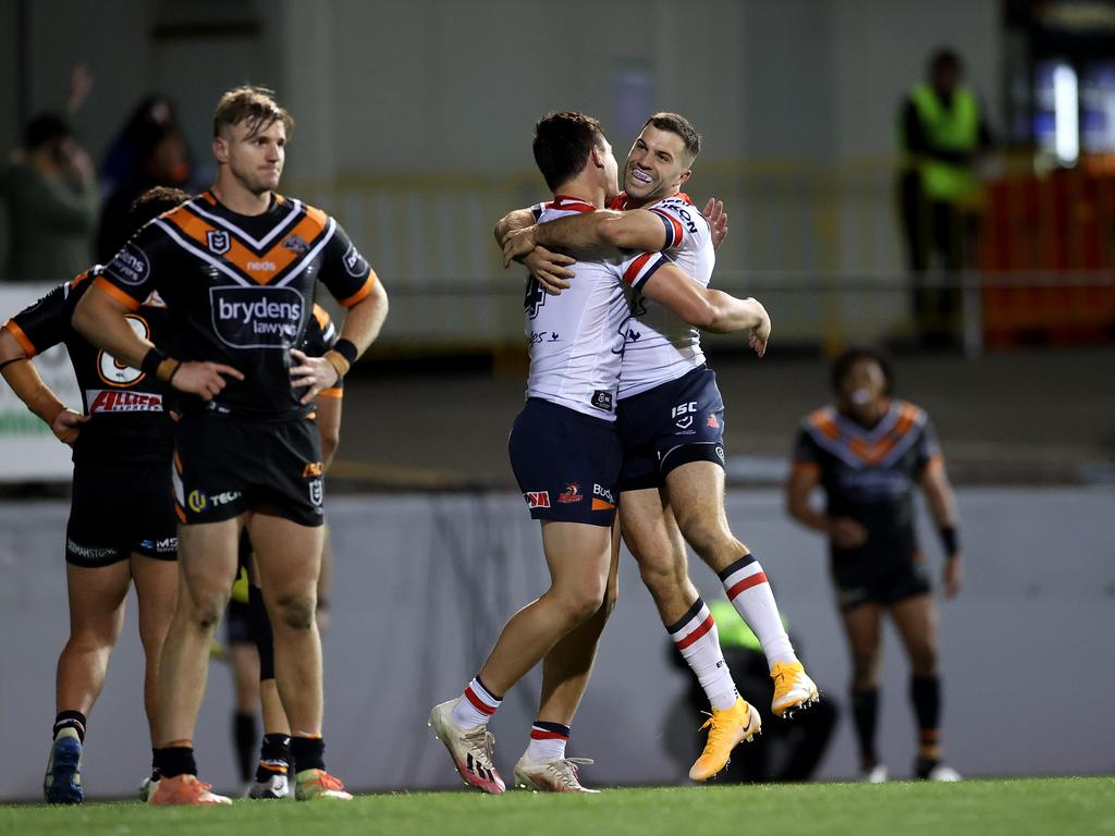 The Roosters celebrate in front of the Tigers.