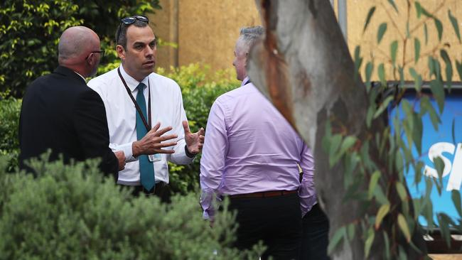 Police officers, including Detective Inspector Mick Haddow, commander of the Sex Crimes Squad, on the grounds of Channel 9. Picture: Phil Hillyard