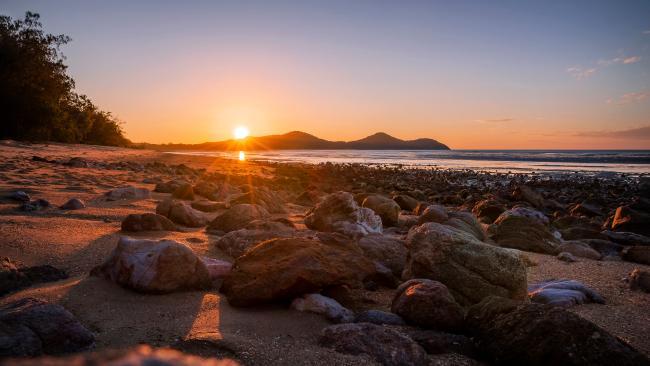 Sunset at Cape Hillsborough. Photograph: Tourism Australia.