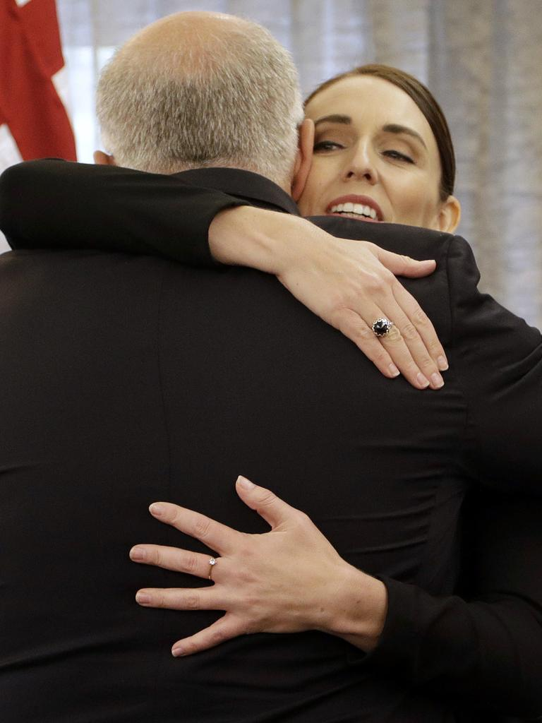 … or hug. Picture: Mark Baker/Getty Images