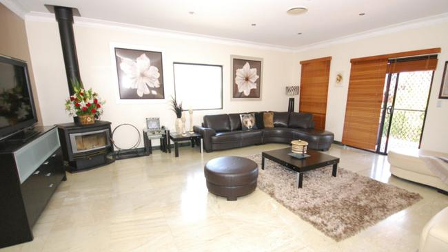 The house at 26 Cusack St has imported marble floors seen in all living areas.