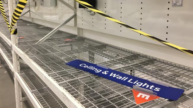 Signage is left abandoned on shelves.