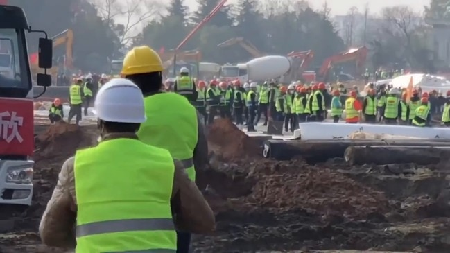 Workers Race to Lay Foundation of New Hospital in Wuhan, China