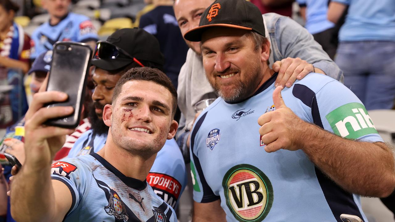 TOWNSVILLE, AUSTRALIA - JUNE 09: Nathan Cleary of the Blues poses with fans after winning game one of the 2021 State of Origin series between the New South Wales Blues and the Queensland Maroons at Queensland Country Bank Stadium on June 09, 2021 in Townsville, Australia. (Photo by Mark Kolbe/Getty Images)