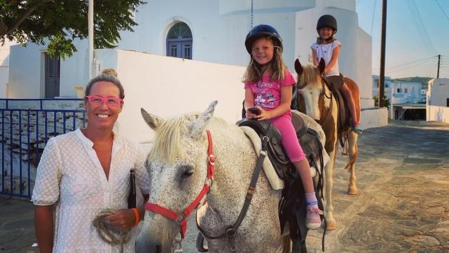 Flip Byrnes with her daughters in Greece. Picture: Supplied