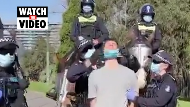 Victorian police put mask on protester