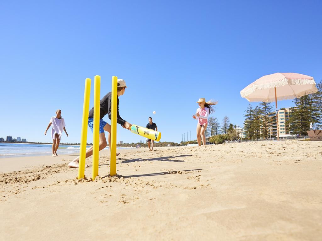 Even a Sunday arvo of beach cricket brings out the Aussie rivalry. Picture: Tourism and Events Queensland