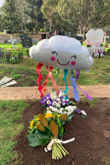 PIC BY REBECCA MARSH / CATERS NEWS (PICTURED balloon at grave) A grieving mum mourning the death of her son has shared her heartache at having to plan a tiny socially-distant funeral - with NO HUGGING -  due to strict COVID-19 restrictions. Heartbroken mum Rebecca Marsh, 41, from Melbourne, Australia, lost her son Jahleel, four, earlier this month after he suffered a sudden cardiac arrest while in hospital. Jahleel – who was the world's youngest Parkinson's sufferer – was due to undergo life-saving surgery in Poland in May, however this was sadly postponed due to COVID-19. Following his sudden death, Bec was faced with the gut-wrenching task of planning a funeral for her son  - which was made 'a million times' harder due to the strict lockdown currently in place in Melbourne that meant she could only invite eight guests. SEE