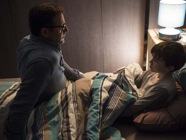 Jason Isaacs, as Michael Carter, with Levi Miller (Mick) in a scene from Red Dog: True Blue. Picture: Roadshow Films
