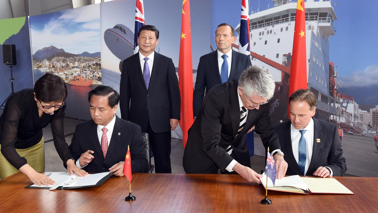 President Xi Jinping and Prime Minister Tony Abbott look on as China's Administrator of the State Oceanic Administration Liu Ciqui and Australia's then-Minister for the Environment Greg Hunt (R) sign a Memorandum of Understanding during a showcase of Australian-Chinese Antarctic cooperation in Hobart during his visit. Picture: AAP/William West