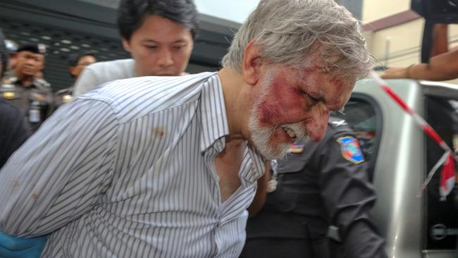 Peter Colter, aka Peter Johnson, is led away after the dismembered body of a blond man was found in a freezer at his Bangkok home. Picture: Reuters/Picture Media