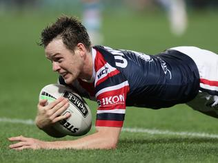 SYDNEY, AUSTRALIA - SEPTEMBER 19: Luke Keary of the Roosters scores a try during the round 19 NRL match between the Sydney Roosters and the Cronulla Sharks at Sydney Cricket Ground on September 19, 2020 in Sydney, Australia. (Photo by Mark Metcalfe/Getty Images)