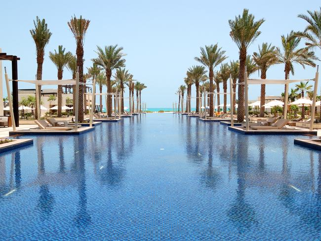 SAADIYAT ISLAND After a tour of the Louvre Abu Dhabi, many travellers head to the beach on Saadiyat island, where for $9 you can swim in the crystal-clear waters and laze on a sun lounge by the shores. You can also nab a day pass to the Saadiyat Beach Club, although at $96 per person, it's an expensive day out. But looking at that view, some would say it's worth it.