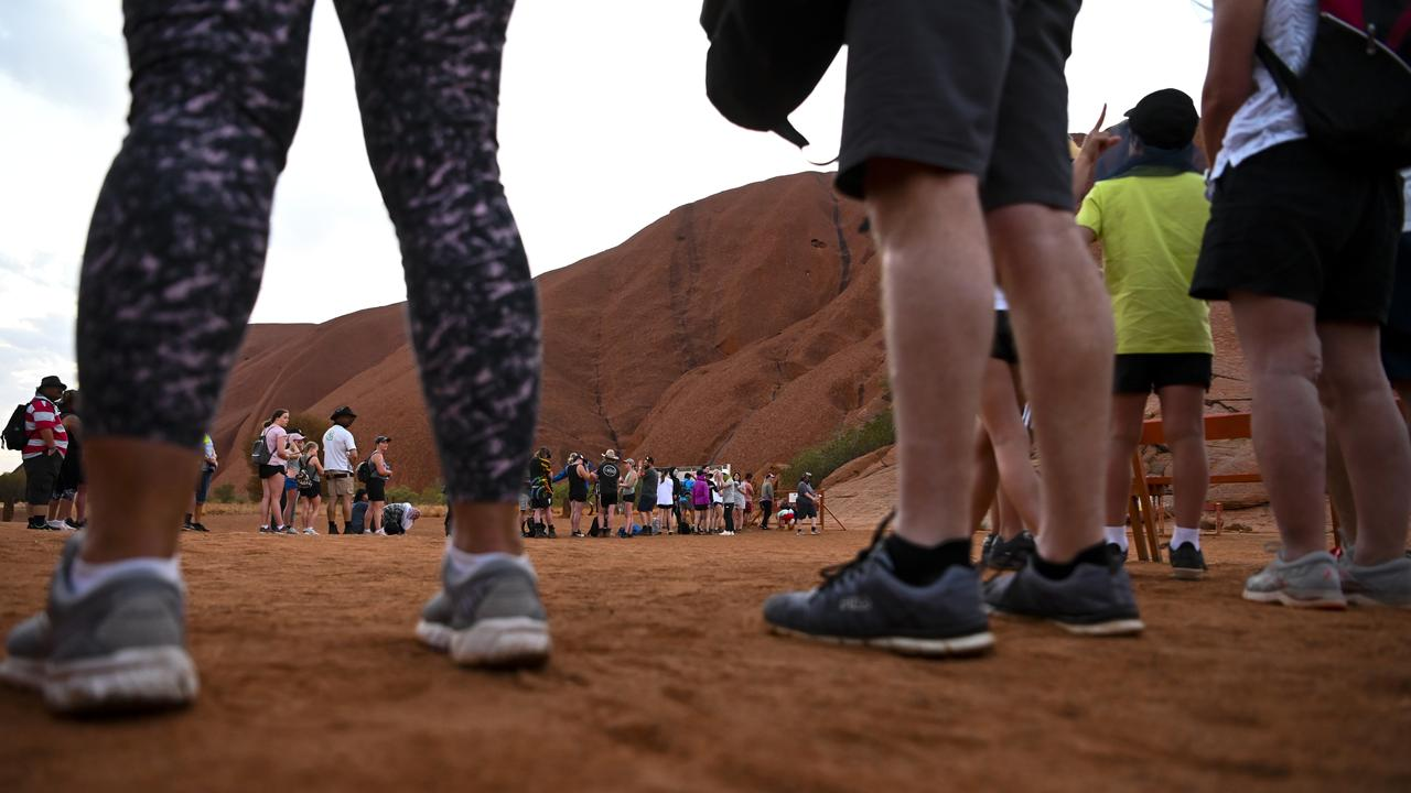 Tourists queue to climb Uluru, NT, on October 13, 2019. Picture: AAP