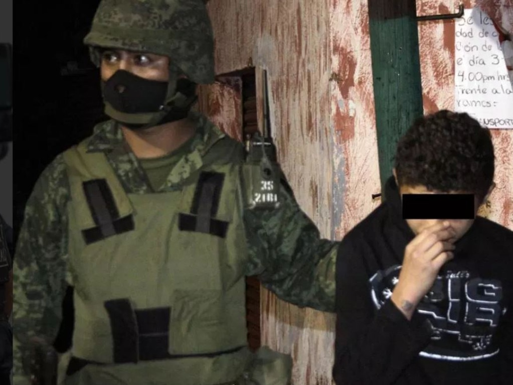 Pictured is a 14-year-old accused of operating as a hit man for a Mexican drug cartel.