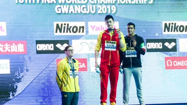 Australian swimmer Mack Horton (left) refusing to take the podum with Sun Yang (centre) at the 2019 world championships. Picture: Visual China Group via Getty Images/Visual China Group via Getty Images