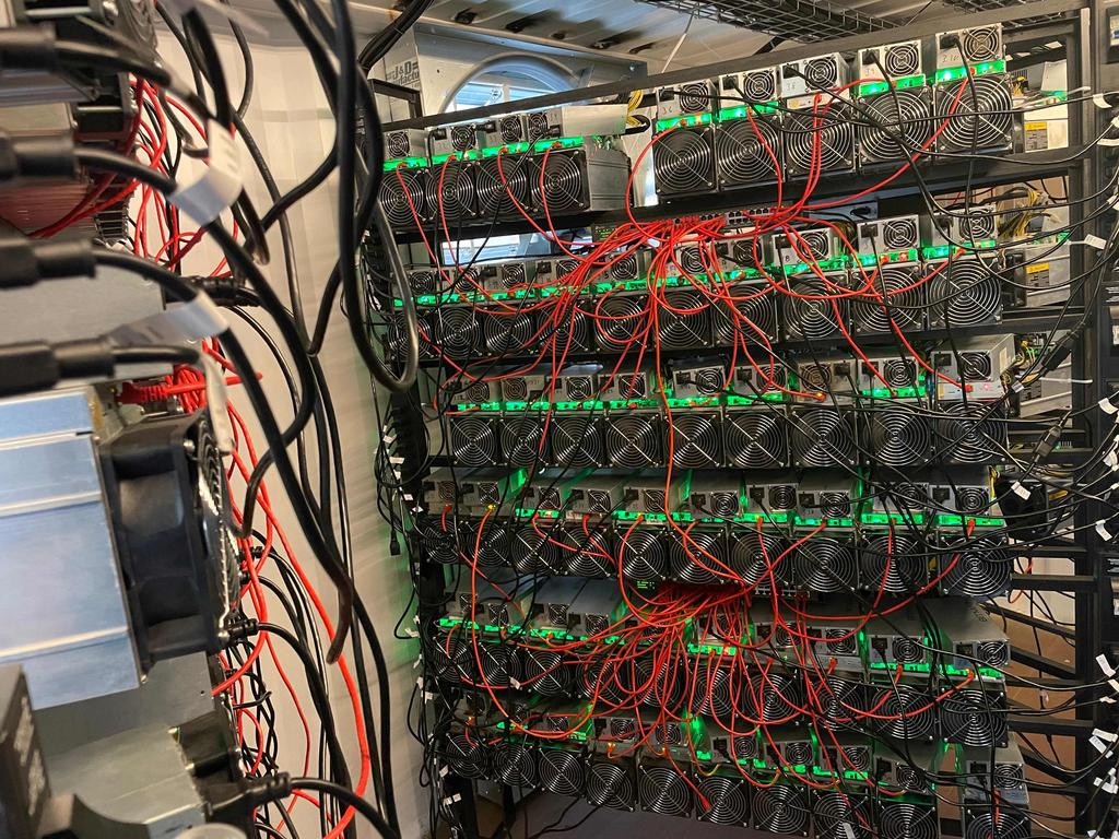 A bitcoin mining data centre is seen on an oilfield in North Texas. Picture: AFP