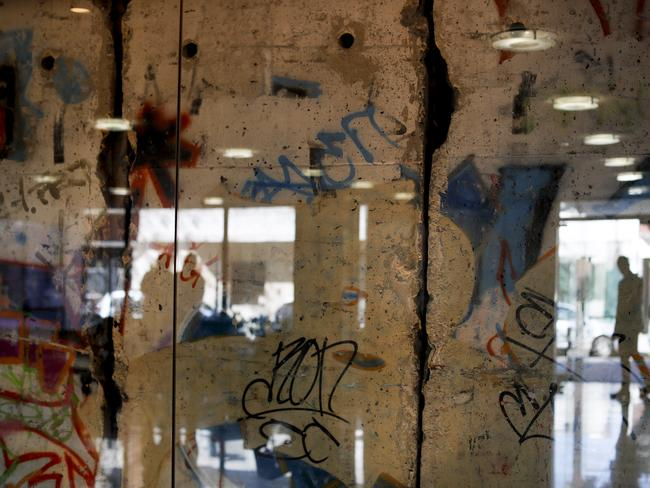 BUENOS AIRES Glass protects a segment of the Berlin Wall at Editorial Perfil in Buenos Aires, Argentina. Picture: AP