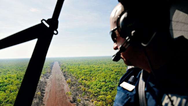 Mataranka police station remote Sergeant Tom Chalk looks over Gorrie Airstrip, an area that NT Police have been searching by ground and air for missing Larrimah resident Patrick Moriarty who hasn't been seen since December 16. PICTURE: Michael Franchi