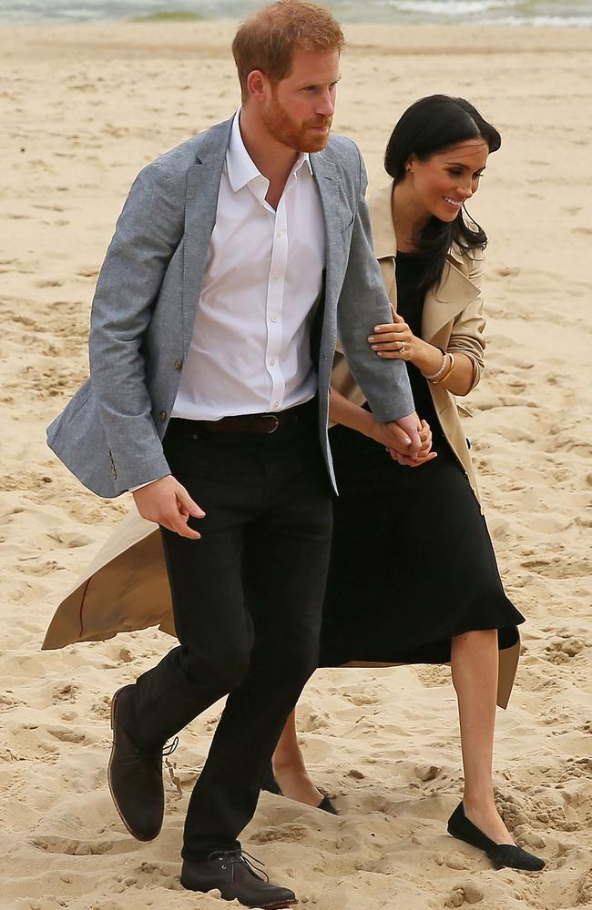 A trip to the beach in South Melbourne didn't stop Meghan Markle from wearing her usual style of clothing — a midi-dress. Picture: Getty Images