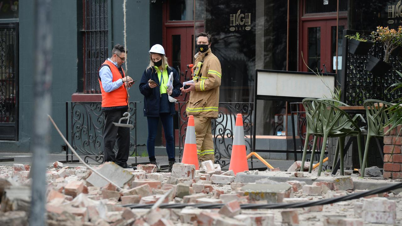 Emergency crews survey the damage on Chapel St. Picture: Andrew Henshaw