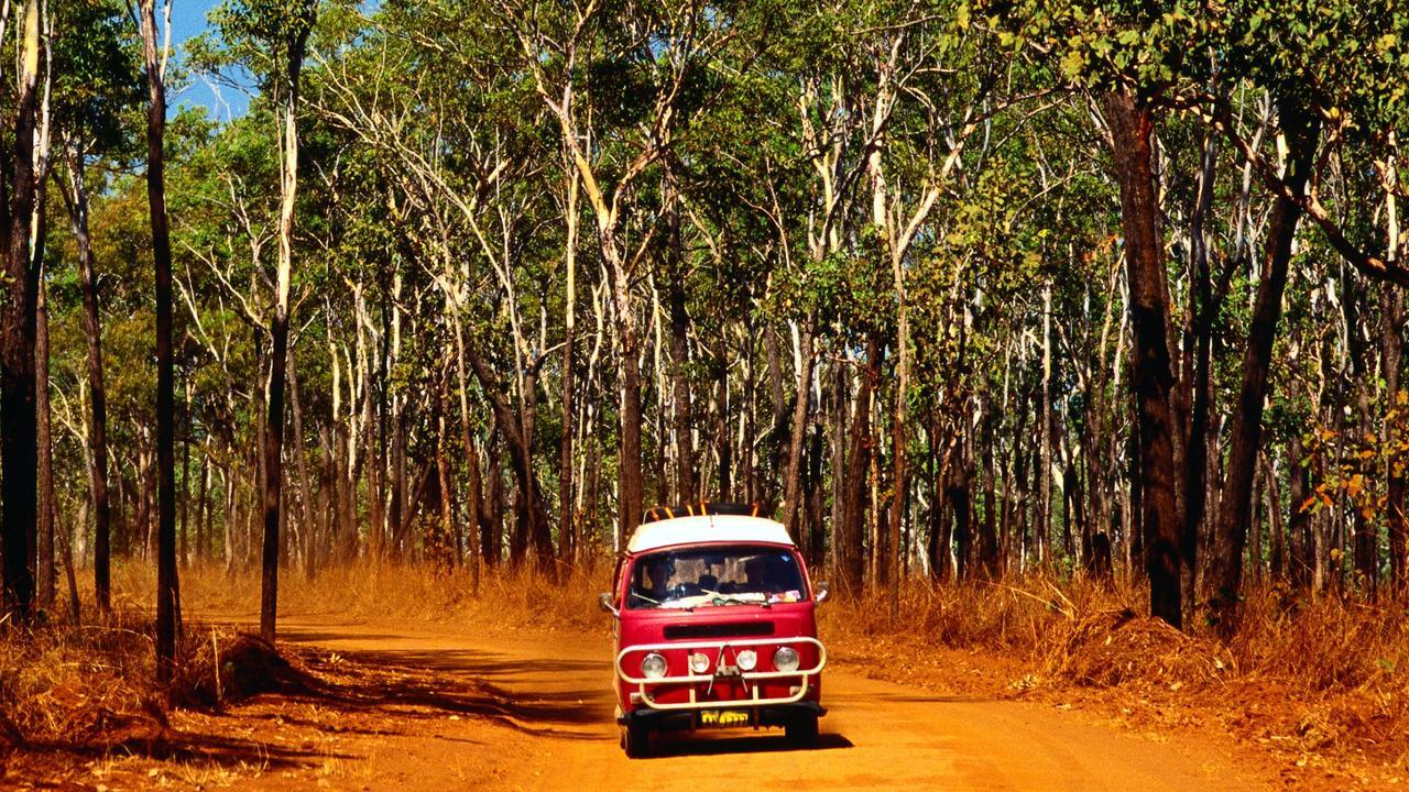 Campervan driving through Kakadu National Park.