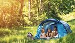Hiker kids sitting in tent in the forest