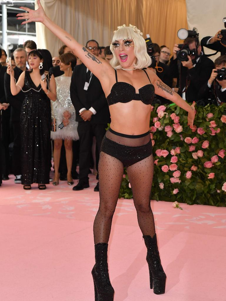 Lady Gaga stripped down to her underwear on last year's pink carpet. Picture: Angela Weiss/AFP