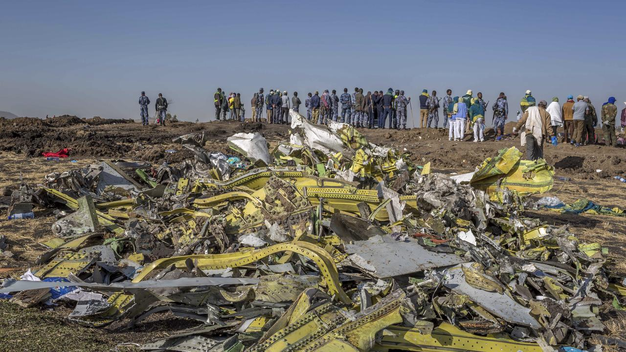 Wreckage is piled at the crash scene of an Ethiopian Airlines flight near Bishoftu, or Debre Zeit, south of Addis Ababa, Ethiopia. Picture: AP Photo/Mulugeta Ayene.