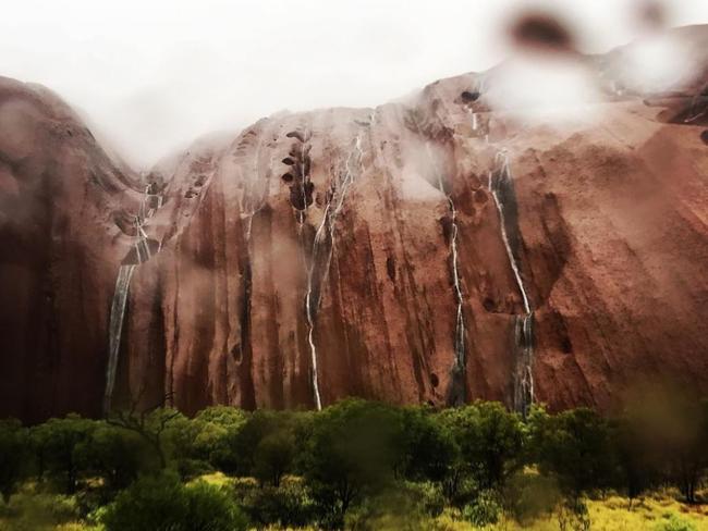 Waterfalls cascade down Uluru during December's storms. Picture: Starfall214/Instagram