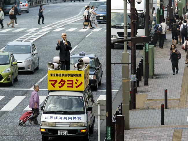 Jesus Matayoshi holds an election sermon atop his campaign mini-van in Tokyo. Picture: Jonas Bendiksen / Magnum Photos / Snapper Media