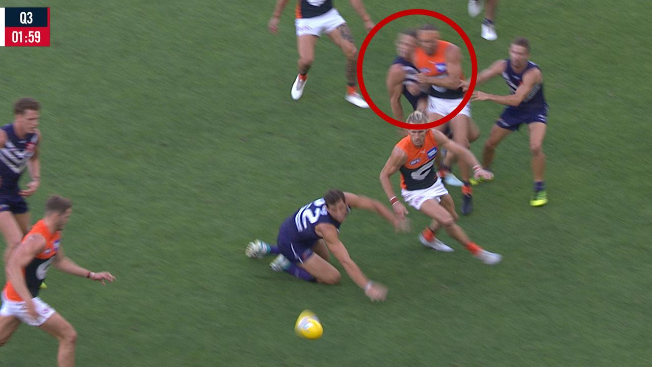 Nat Fyfe collides with Sam Reid.