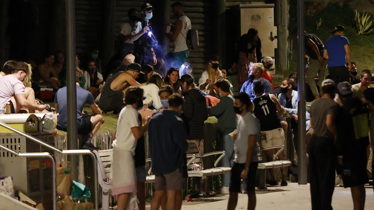 A large amount of people went to Biddigal Reserve at Bondi Beach on Friday night. Picture: Jonathan Ng