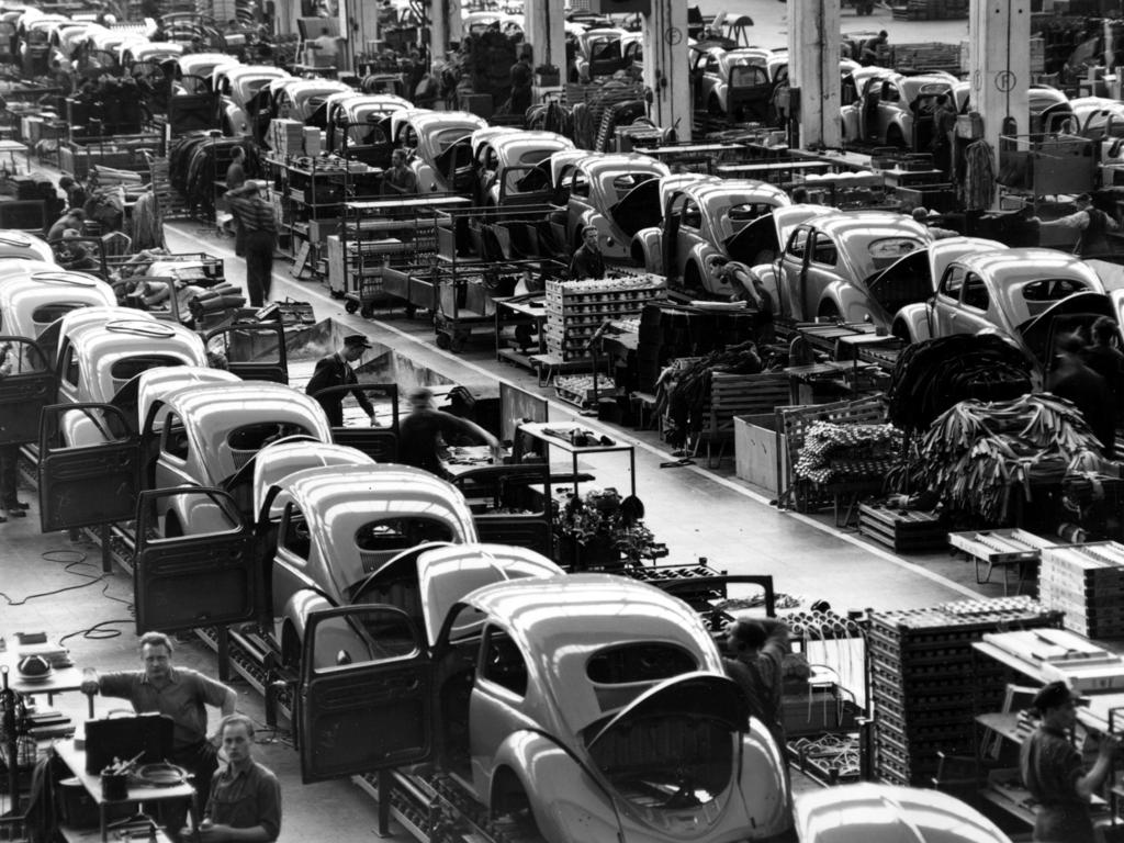 Beetles are assembled in lines at the Volkswagen auto works plant in Wolfsburg, West Germany in 1954. Picture: AP/Albert Riethausen