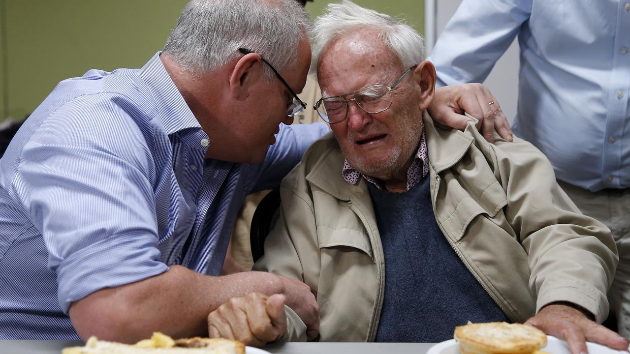 Scott Morrison comforts 85-year-old Owen Whalan at a Taree evacuation centre. Picture: Darren Pateman/AAP
