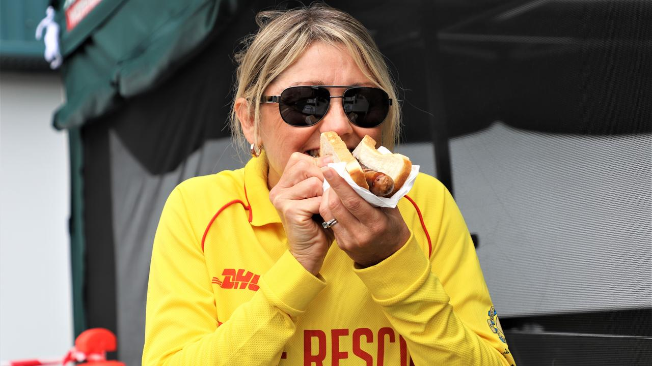 Everyone's favourite sausage sizzle supports community fundraisers including the Surf Life Saving Club. Image: Supplied